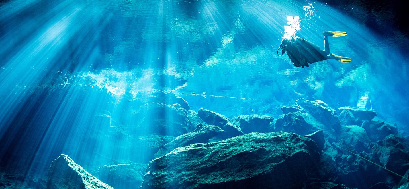 Scuba diver in deep ocean water