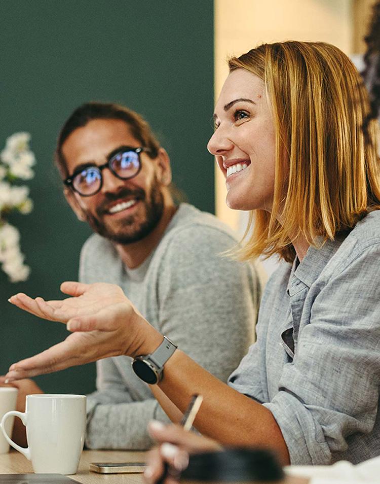Beautiful lush green mountain range with man looking off the ridge